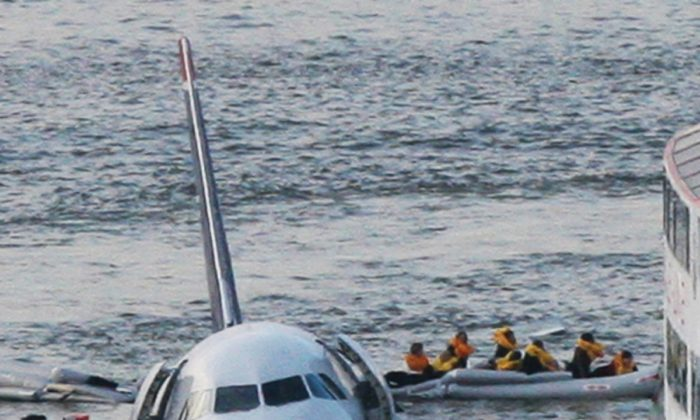In this file photo, passengers in an inflatable raft move away from an Airbus 320 US Airways aircraft that has gone down in the Hudson River in New York. (AP Photo/Bebeto Matthew)
