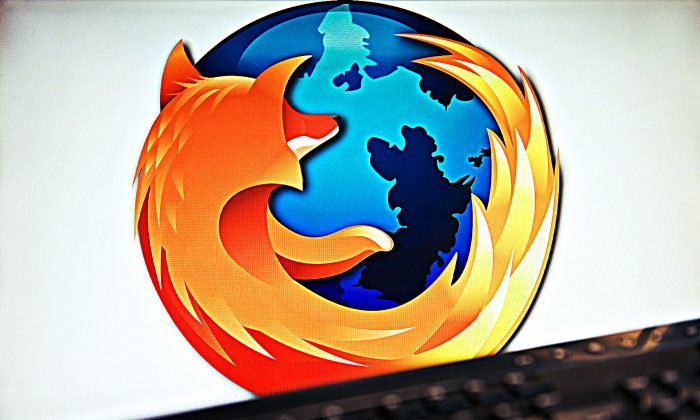 A screen displays the logo of the open-source web browser Firefox on July 31, 2009, in London. (Leon Neal/AFP/Getty Images; effects added by Epoch Times)