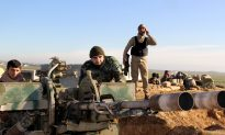 Iraq Premier Says Ground Troops Need More Aid