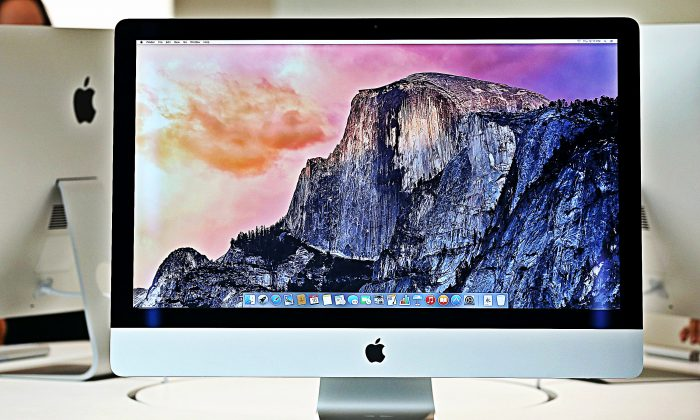 The new 27 inch iMac with 5K Retina display is displayed during an Apple special event on Oct. 16, 2014 in Cupertino, Calif. (Justin Sullivan/Getty Images; effects added by Epoch Times)