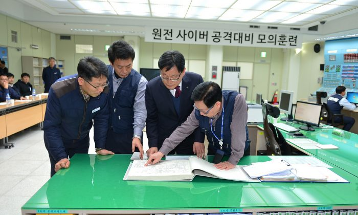 In this handout provided by the Korea Hydro and Nuclear Power Co., workers of the Korea Hydro and Nuclear Power Co. participate in anti cyber attack exercise at Wolsong power plant on Dec. 22, 2014 in Gyeongju, South Korea. On Jan. 21, 2015 hackers leaked blueprints for South Korean power plants. (Photo by Korea Hydro and Nuclear Power Co. via Getty Images)