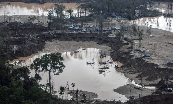 View of camps surrounding pumps used for illegal gold mining in the Madre de Dios region of Peru, January 2014. New research shows that these small-scale mines put hazardous levels of mercury into the environment. (Sebastian Castañeda/AFP/Getty Images)