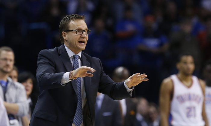 Oklahoma City Thunder head coach Scott Brooks shouts to his team in the fourth quarter of an NBA basketball game against the Utah Jazz in Oklahoma City, Friday, Jan. 9, 2015. Oklahoma City won 99-94. (AP Photo/Sue Ogrocki)