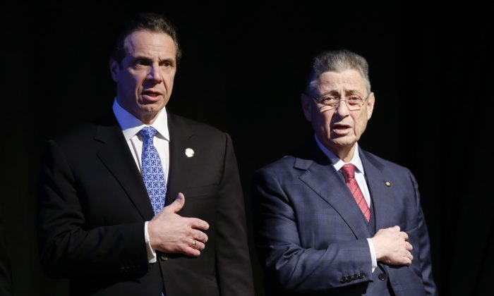 Assembly Speaker Sheldon Silver (D-Manhattan) (R) stands with New York Gov. Andrew Cuomo before Cuomo's State of the State address and executive budget proposal at the Empire State Plaza Convention Center in Albany, N.Y., on Jan. 21, 2015. Silver, who has been one of the most powerful men in Albany for more than two decades, was arrested Thursday on public corruption charges. (AP Photo/Mike Groll)