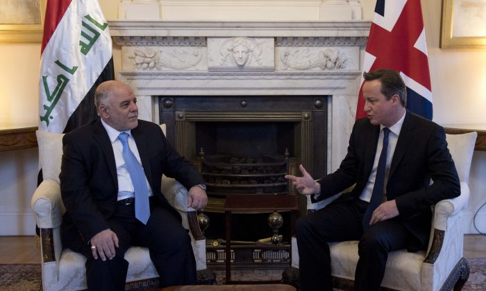 British Prime Minister David Cameron (R) speaks with Iraqi Prime Minister Haider al-Abadi (L), as they meet at 10 Downing Street, London, Thursday, Jan. 22 2015. Al-Abadi is in London to attend a meeting Thursday on the country's beleaguered efforts to combat Islamic State. (AP Photo/Will Oliver)