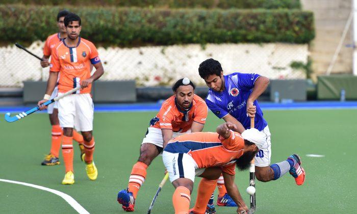 Play in a recent match between Punjab-A and Khalsa-A at King's Park. (Bill Cox/Epoch Times)