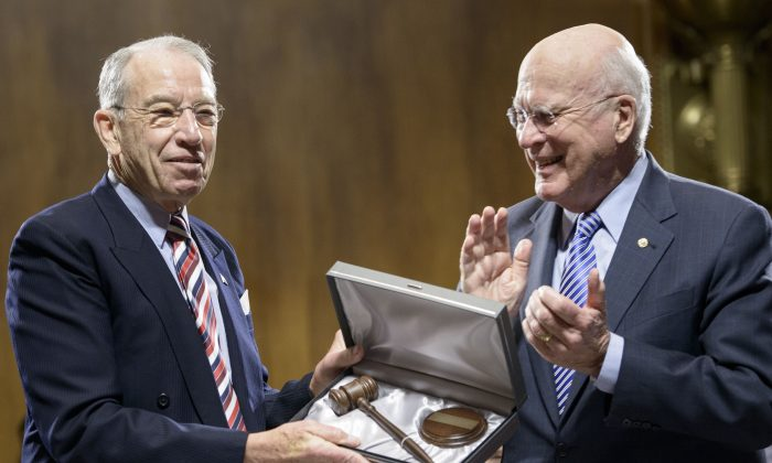 Former committee chairman Sen. Patrick J. Leahy (R) (D-Vt.) presents a gavel to new committee chairman Sen. Chuck Grassley (R-Iowa) during a meeting of the Senate Judiciary Committee on Capitol Hill on Jan. 22, 2015. (Brendan Smialowski/AFP/Getty Images)