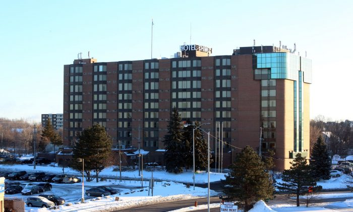 The Chimo Hotel, the scene of an evacuation and police investigation, is shown in Ottawa on Wednesday, Jan. 21, 2015. A 42-year-old man was arrested without incident at the hotel after police found his vehicle.  (The Canadian Press/Fred Chartrand)