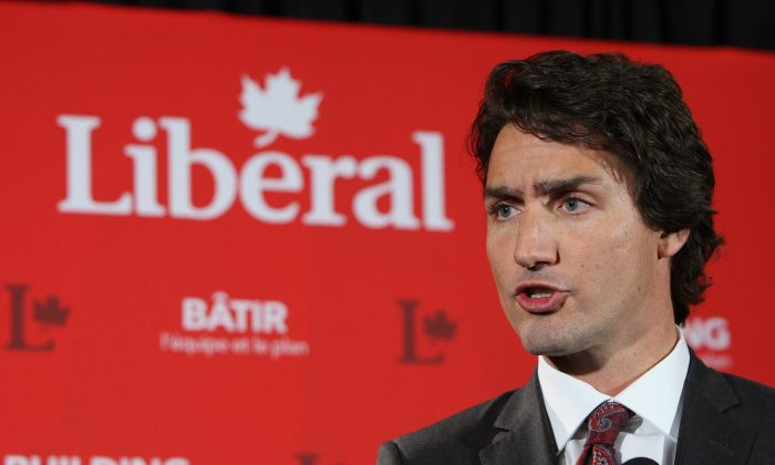 Liberal Leader Justin Trudeau speaks to the media at the Liberal party's winter caucus meeting in London, Ont., on Jan. 20, 2015. Trudeau won't say if he thinks the federal government should abandon its commitment to a balanced budget given the economic turmoil caused by plunging oil prices. (The Canadian Press/Dave Chidley)
