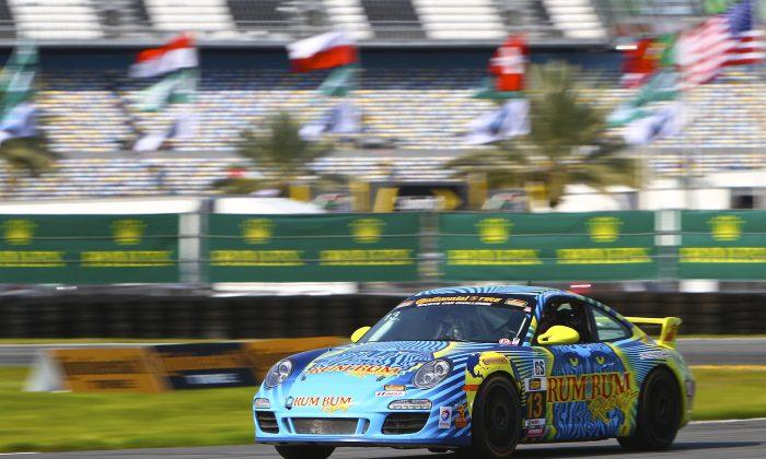 Hugh and Matt Plumb drove the #13 Rum Bum Racing Porsche 911 to the overall win in the Continental Tire Sports Car Challenge BMW Performance 200 at Daytona International Speedway Jan. 24 2015. (Halston Pitman/MotorsportsMedia)