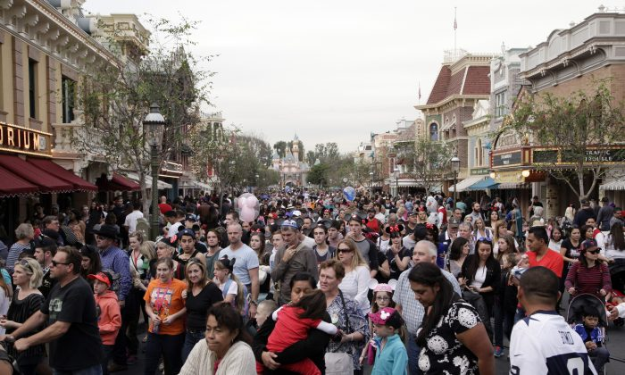 A crowd of people leave Disneyland after watching a parade in Anaheim, Calif., on Jan. 22, 2015. (Jae C. Hong/AP Photo)