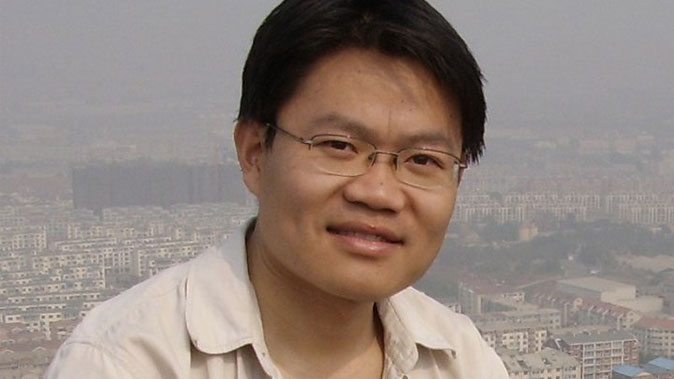 Chinese human rights lawyer Wang Yonghang is paralyzed after being severely tortured since being imprisoned in prison in China since 2009. (New Tang Dynasty Television)