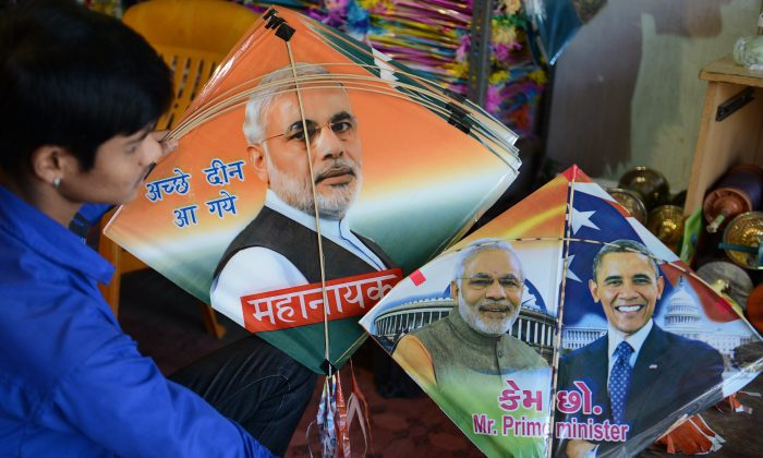 An Indian vendor in Hyderabad, on Jan. 7, 2015, displays kites printed with the portraits of Prime Minister Narendra Modi and U.S. President Barack Obama, who is expected to visit India for the forthcoming Republic Day celebrations, ahead of the forthcoming Makar Sankranti kite festival. (Noah Seelam/AFP/Getty Images)