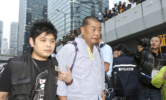 Hong Kong media tycoon Jimmy Lai on Dec. 11, 2014. His mansion and the Next Media building were firebombed on Jan. 12, 2015, and Hong Kong people are concerned the attacks were connected to the Chinese regime. (Yu Kong/Epoch Times)