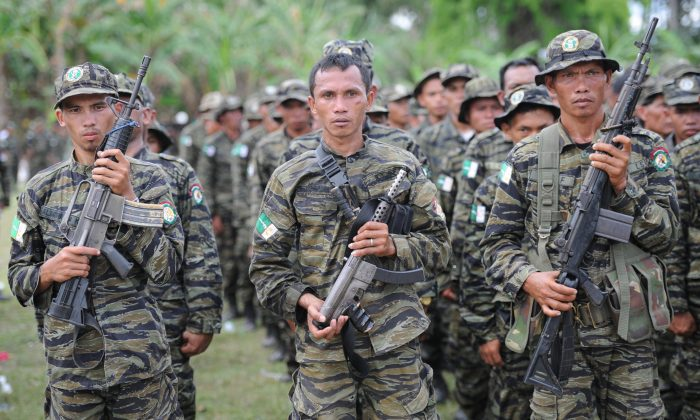 Moro Islamic Liberation Front (MILF) rebels attend a rally in support of the peace agreement with the government inside Camp Darapanan in Sultan Kudarat town, on southern island of Mindanao on March 27, 2014. (Ted Aljibe/AFP/Getty Images)