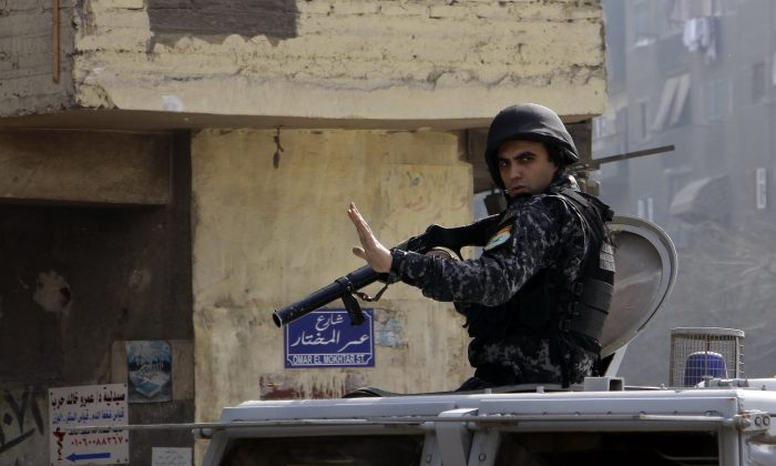 Egyptian security forces deploy in the Cairo suburb of Matariyah, Egypt, Sunday, Jan. 25, 2015. (AP Photo/Ahmed Abdel Fattah)