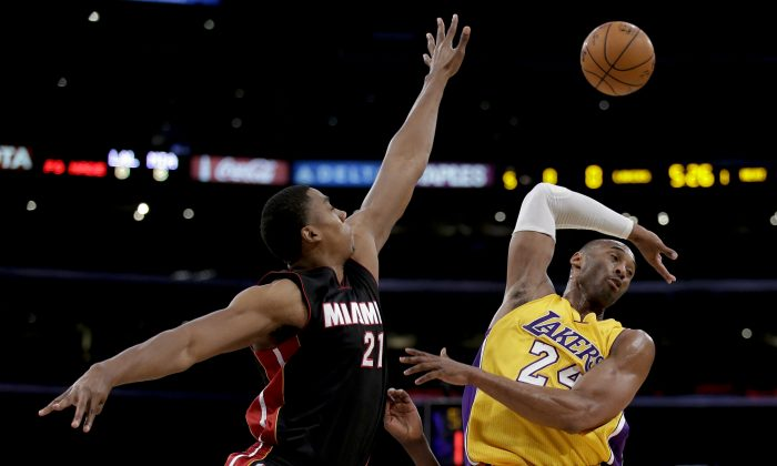 Miami Heat center Hassan Whiteside, left, blocks a shot by Los Angeles Lakers guard Kobe Bryant during the first half of an NBA basketball game in Los Angeles, Tuesday, Jan. 13, 2015. (AP Photo/Chris Carlson)