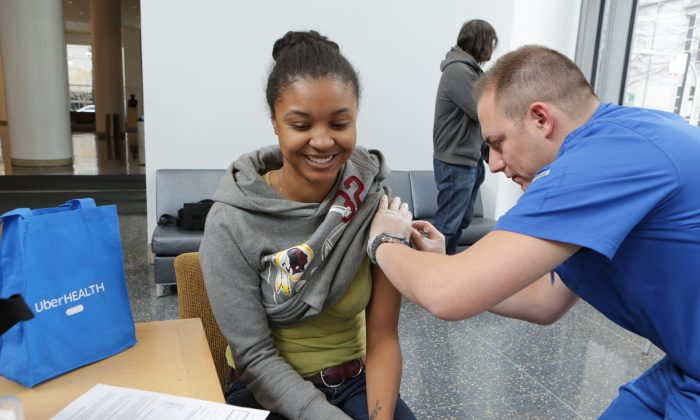 A student gets a flu vaccination in Chicago on Nov. 18, 2014. (Jean-Marc Giboux/AP Images for Uber)