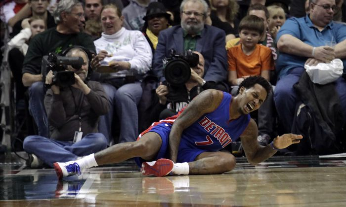 Detroit Pistons guard Brandon Jennings shouts after falling to the floor while playing against the Milwaukee Bucks during the second half of an NBA basketball game Saturday, Jan. 24, 2015, in Milwaukee. (AP Photo/Darren Hauck)