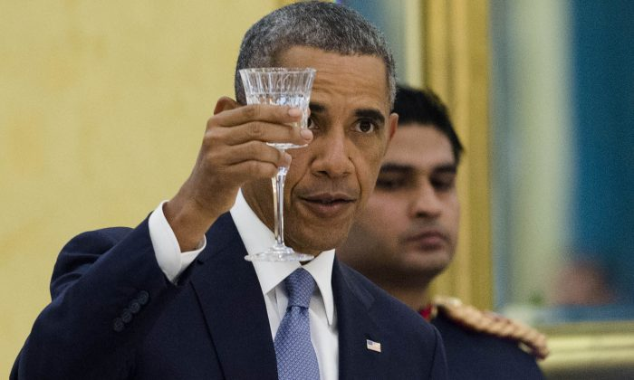 US President Barack Obama makes a toast during a State Dinner at Rashtrapati Bhawan, the Presidential Palace, in New Delhi, India, on Jan. 25, 2015. The United States and India resolved several key obstacles in an agreement that would allow US companies to build up to $182 billion in atomic power plants and reactors in India. (SAUL LOEB/AFP/Getty Images)