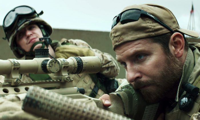 """In this image released by Warner Bros. Pictures, Kyle Gallner, left, and Bradley Cooper appear in a scene from """"American Sniper.""""  The film is based on the autobiography by Chris Kyle. (AP Photo/Warner Bros. Pictures)"""
