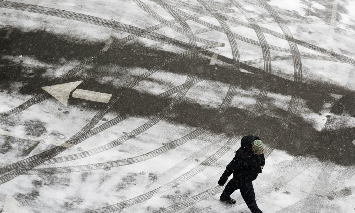 New York Gov. Andrew Cuomo issued a driving ban for Bronx, Dutchess, Kings, Nassau, New York, Orange, Putnam, Queens, Richmond, Rockland, Suffolk, Ulster and Westchester counties. A pedestrian crosses a snowy parking lot before heavy snowfall arrives, Monday, Jan. 26, 2015, in New York. Northeast residents are girding for a heavy snowstorm that could bury communities from northern New Jersey to southern Maine in up to 2 feet of snow. (AP Photo/Mark Lennihan)
