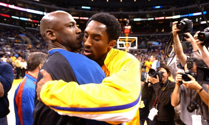 Michael Jordan (L) of the Washington Wizards and Kobe Bryant of the Los Angeles Lakers embrace before the start of their 12 February 2002 game in Los Angeles, CA. The Lakers won the game, 103-94. (AFP/Getty Images)