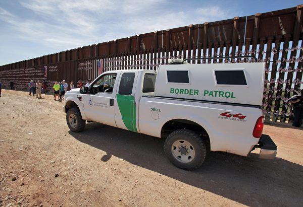A U.S. Customs and Border Patrol agent patrols along the Arizona-Mexico border wall Sunday, Aug. 15, 2010 in Hereford, Ariz. (AP Photo/Matt York)