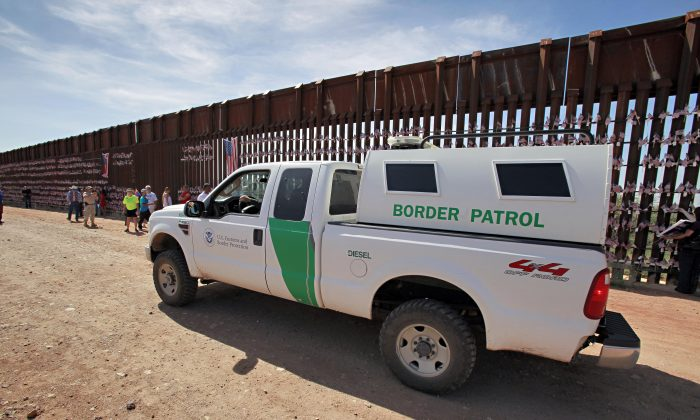 A U.S. Customs and Border Patrol agent patrols along the Arizona-Mexico border wall on Aug. 15, 2010 in Hereford, Ariz. (AP Photo/Matt York)