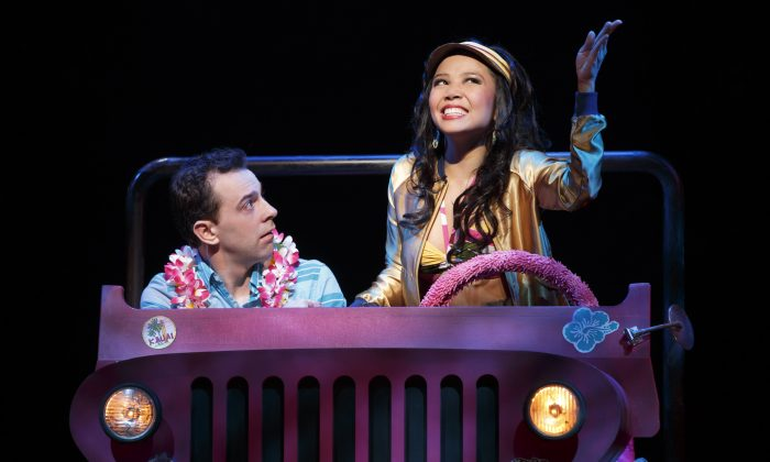 "Rob McClure stars in the very funny if over the top musical ""Honeymoon in Vegas."" Here Catherine Ricafort plays a Hawaiian tour guide who tries to seduce him. (AP Photo/Boneau/Bryan-Brown; Joan Marcus)"