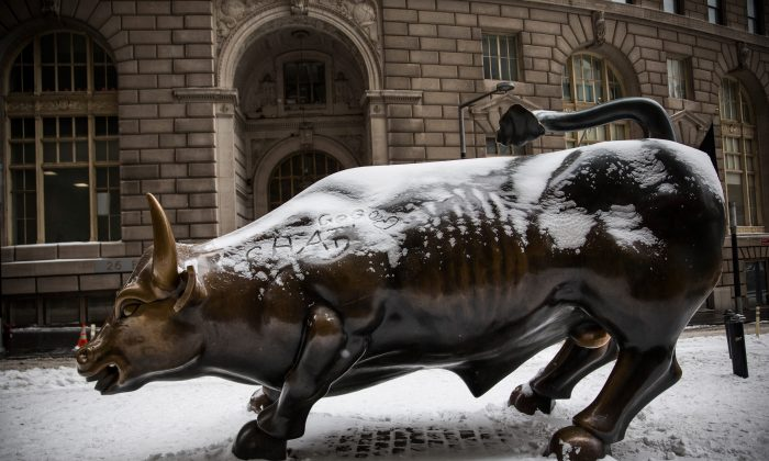 The Wall Street Bull is covered in snow the morning after a snowstorm on Jan. 27, 2015. (Andrew Burton/Getty Images)
