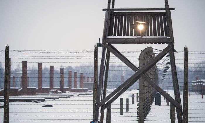 A watch tower stands along a barbed wire fence at the memorial site of the former Auschwitz-Birkenau concentration camp on the eve of the 70th anniversary of the liberation of the Nazi death camp in Oswiecim, Poland, on Jan. 26, 2015. (Odd Andersen/AFP/Getty Images)