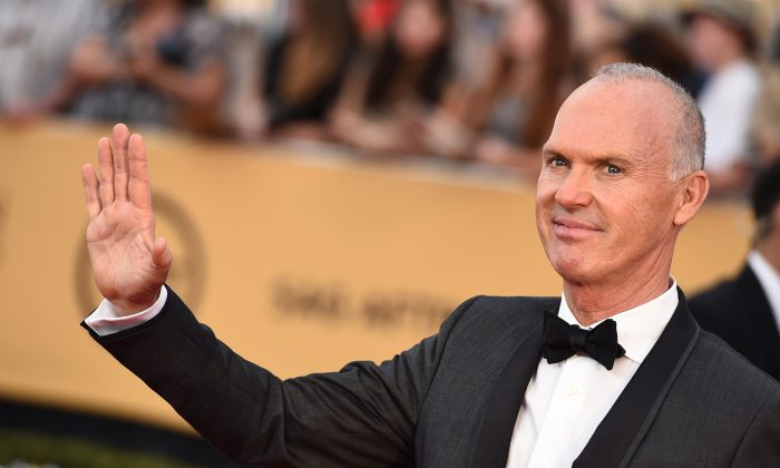 Michael Keaton at the Shrine Auditorium in Los Angeles on Sunday, Jan. 25, 2015. Keaton reveals his interest in current events by posting newspaper articles on his social media accounts. (Photo by Jordan Strauss/Invision/AP)
