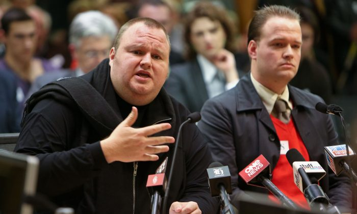Kim Dotcom speaks while Bram van der Kolk looks on during an Intelligence and Security Committee hearing at Bowen House on July 3, 2013 in Wellington, New Zealand. Mr. Dotcom challenged the Prime Minister to meet ahead of Security and Intelligence talks. Mr. Dotcom believes the new bill is wrong. (Hagen Hopkins/Getty Images)