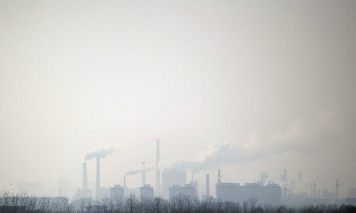 Smoke rises in the air from a chemical factory near Hengshui in northern China's Hebei Province, on Dec. 22, 2014. Many men have died from cancer in a village in southern China surrounded by dozens of factories emitting high levels of pollutants. (Fred Dufour/AFP/Getty Images)