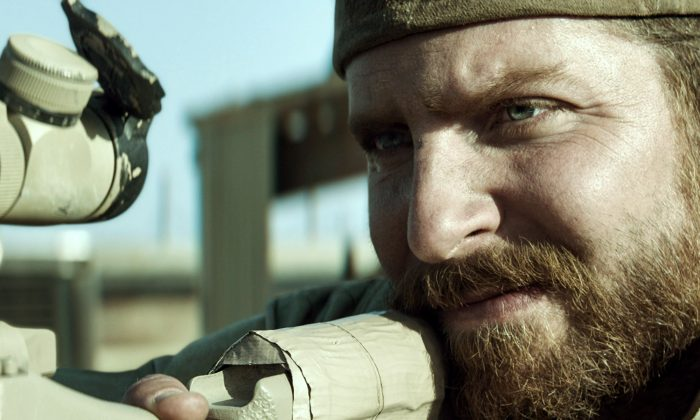 "In this image released by Warner Bros. Pictures, Bradley Cooper portrays Navy SEAL Chris Kyle in a scene from ""American Sniper."" Former Navy SEAL and Minnesota Gov. Jesse Ventura, who won $1.8 million in a defamation lawsuit last year against the estate of the late Chris Kyle, says he won't see the film partly because Kyle is no hero to him. He tells The Associated Press a hero must be honorable, and there' no honor in lying. Lyle claimed in his ""American Sniper"" book that he punched out a man, whom he later identified as Ventura, at a California bar in 2006 for allegedly saying the SEALs ""deserve to lose a few"" in Iraq. Ventura said it never happened. (AP Photo/Warner Bros. Pictures)"
