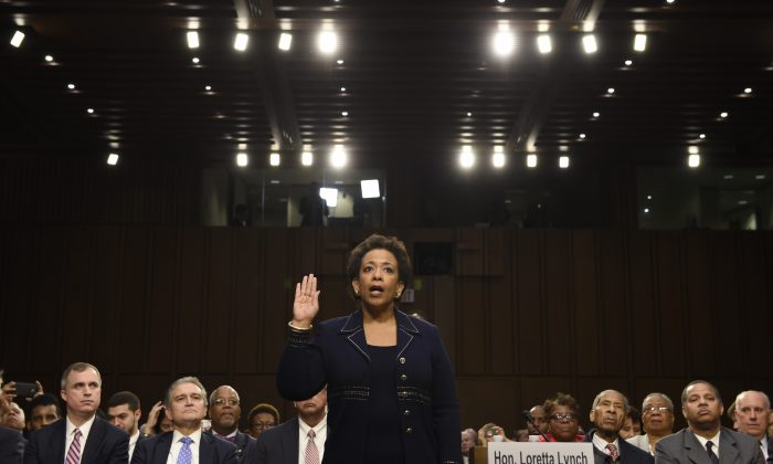 U.S. Attorney General nominee Loretta Lynch is sworn in on Capitol Hill in Washington, Wednesday, Jan. 28, 2015, prior to testifying before the Senate Judiciary Committee's hearing on her nomination. If confirmed, Lynch would  be the nation''s first black female attorney general. (AP Photo/Susan Walsh)