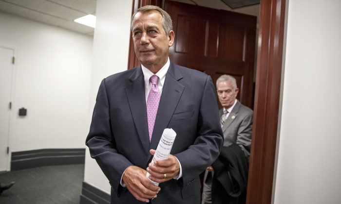 House Speaker John Boehner of Ohio, followed by Rep. Bill Johnson, R-Ohio, emerges from a closed-door strategy session with House Republicans, on Capitol Hill in Washington, Tuesday, Jan. 27, 2015. (AP Photo/J. Scott Applewhite)