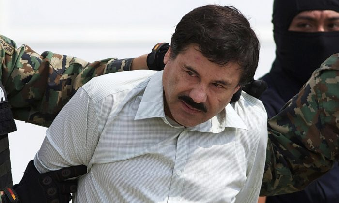 "Joaquin ""El Chapo"" Guzman is escorted to a helicopter in Mexico City following his capture, on Feb. 22, 2014. (Eduardo Verdugo/AP Photo)"