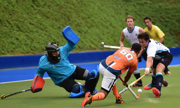 Action from the Khalsa-A against HKFC at King's Park earlier in the season when Khalsa-A won the match 8-2. Khalsa-A won their latest encounter with HKFC-A 5-1 at HKFC on Sunday Jan 25, 2015. (Bill Cox/Epoch Times)