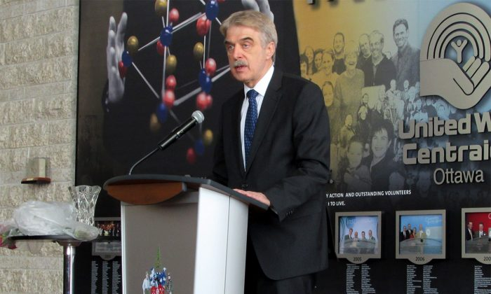 Germany's ambassador to Canada Werner Wnendt speaks at a ceremony at Ottawa City Hall to mark the 70th anniversary of the liberation of Auschwitz-Birkenau and the 10th annual International Holocaust Remembrance Day, Jan. 27, 2015. (Limin Zhou/Epoch Times)