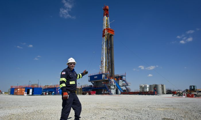 Jeff Boggs, responsible for the drilling at Consol Energy poses, in front of one of the company's horizontal gas drilling rigs exploring the Marcellus Shale outside the town of Waynesburg, Pa., on April 13, 2012. (Mladen Antonov/AFP/Getty Images)