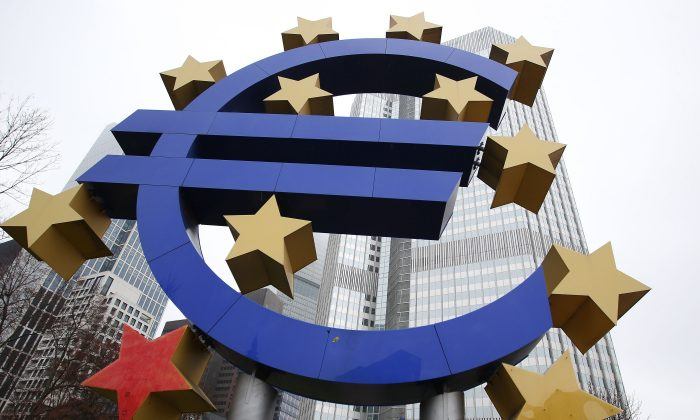 The euro sign sculpture in front of the building that used to host the headquarters of the European Central Bank in Frankfurt, Germany, on Jan. 26, 2015. (Daniel Roland/AFP/Getty Images)
