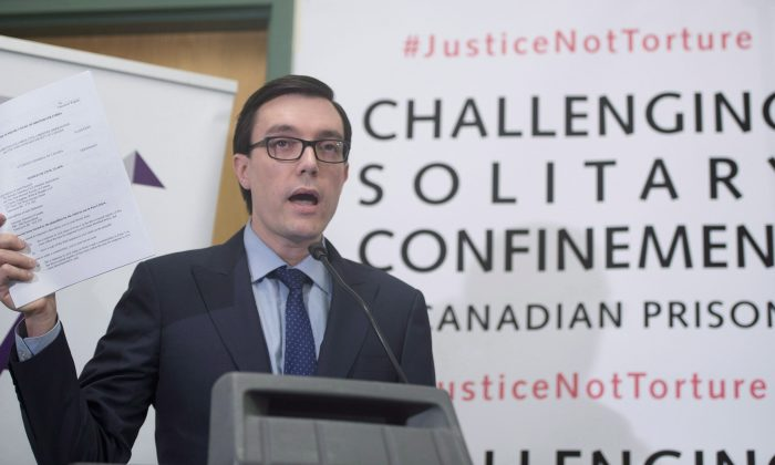 Josh Paterson of the British Columbia Civil Liberties Association addresses a news conference in Vancouver on Jan. 19, 2015. The BCCLA and the John Howard Society have filed a lawsuit against the Attorney General of Canada regarding the use of solitary confinement in prisons. (The Canadian Press/Jonathan Hayward)