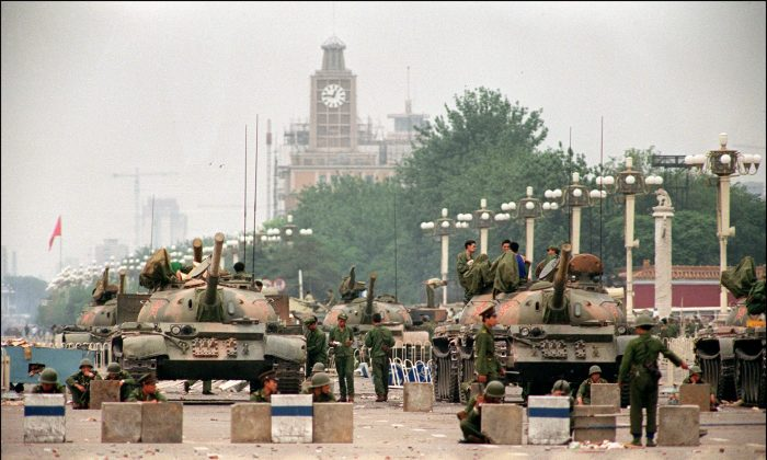"People's Liberation Army tanks guard strategic Chang'an Avenue leading to Tiananmen Square on June 6, 1989. Canadian officials stationed in Beijing at the time described China's Communist Party leadership as a ""gerontocracy"" that was ""bereft of any credible claim to legitimacy,"" according to cables obtained by Blacklock's Reporter. (Manuel Ceneta/AFP/Getty Images)"