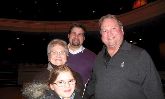 Oakwood Mayor Bill Duncin (R) and family enjoyed the cultural experience of Shen Yun at Dayton's Mead Theater, on Jan. 28, 2015. (Sherry Dong/Epoch Times)