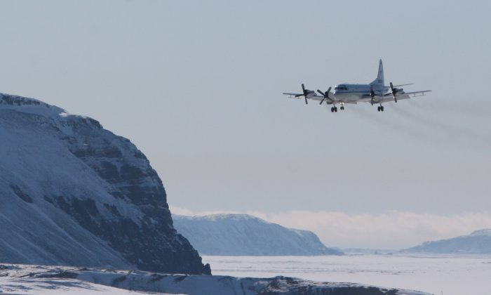 A photo of a plane landing shows NASA's P-3B aircraft at Thule Air Base in Greenland. (NASA)