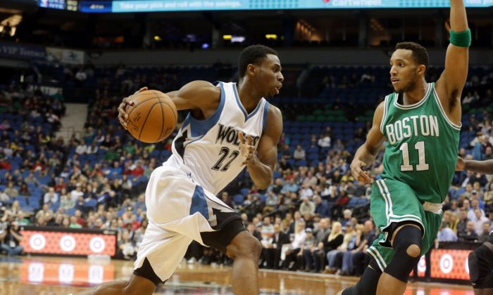 Minnesota Timberwolves' Andrew Wiggins, left, drives toward Boston Celtics' Evan Turner in the second half of an NBA basketball game, Wednesday, Jan. 28, 2015, in Minneapolis. The Timberwolves won 110-98. (AP Photo/Jim Mone)