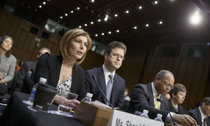 Investigative reporter Sharyl Attkisson, left, joined at right by attorney David Barlow, and other witnesses, testifies before the U.S. Senate Judiciary Committee as it continues for the second day of confirmation hearings for President Barack Obama's attorney general nominee, Loretta Lynch, on Capitol Hill in Washington, Thursday, Jan. 29, 2015. Lynch did not appear at the second and final day of her confirmation hearing, which was designed instead to feature testimony from outside experts.  (AP Photo/J. Scott Applewhite)
