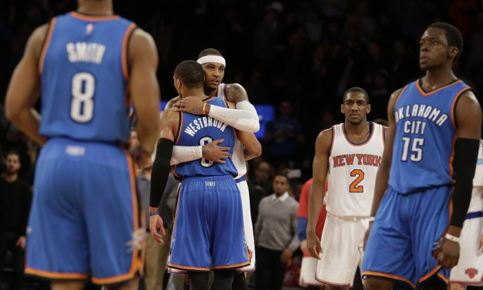 New York Knicks forward Carmelo Anthony hugs Oklahoma City Thunder guard Russell Westbrook (0) at the end of an NBA basketball game, Wednesday, Jan. 28, 2015 at Madison Square Garden in New York.  The Knicks won 100-92. (AP Photo/Mary Altaffer)